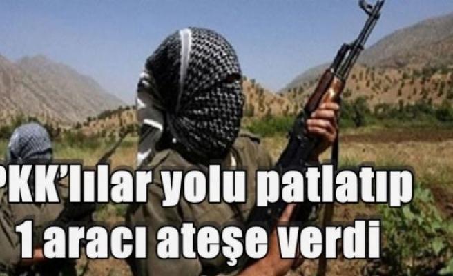 PKK'lılar yolu patlatıp 1 aracı ateşe verdi