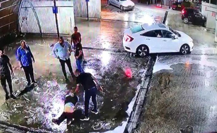 Oto yıkama dükkanında darbedildikten sonra aracın çarptığı kişi yaşam mücadelesini kaybetti